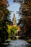 Bruges canal and cathedral beyond