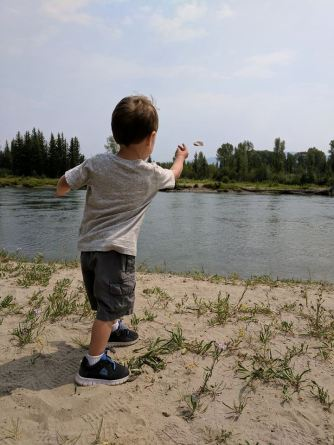 Throwing rocks into the Snake RIver